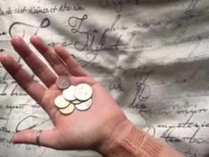 hand holding change